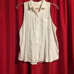 White sleeveless button down top